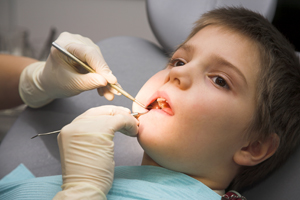 Child having teeth checked